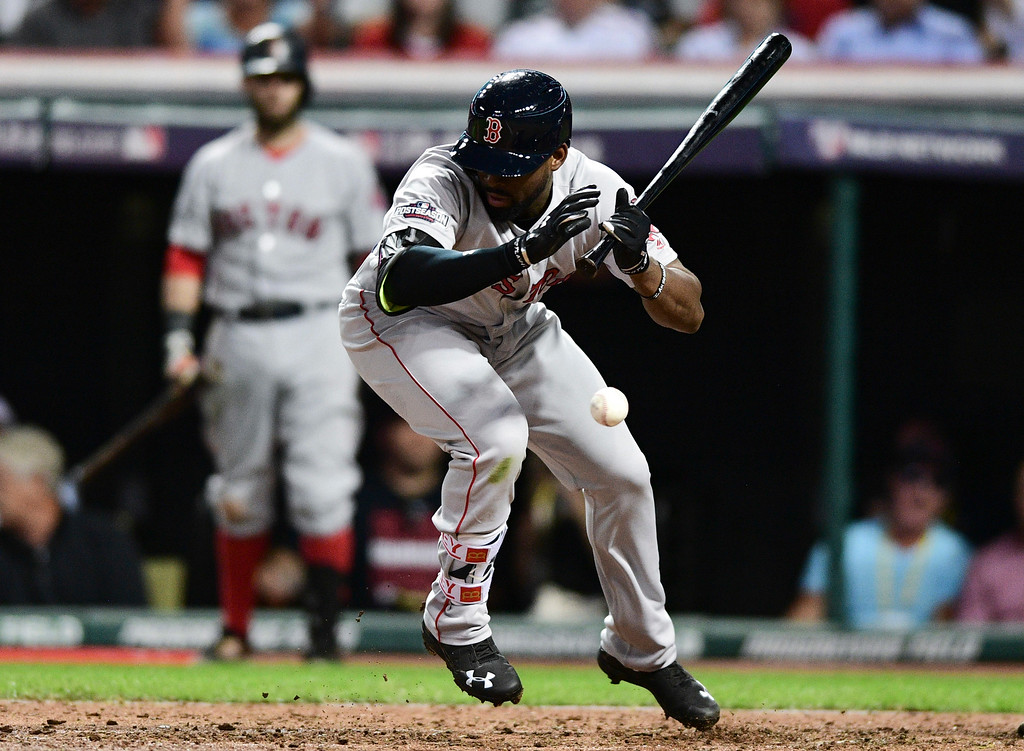 . Boston Red Sox\'s Jackie Bradley Jr. is hit by a pitch from Cleveland Indians\' Corey Kluber in the eighth inning during Game 2 of baseball\'s American League Division Series, Friday, Oct. 7, 2016, in Cleveland. (AP Photo/David Dermer)