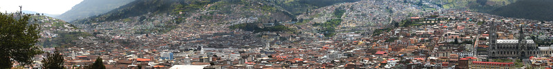 """This view encompasses the entire area from the winged Madonna, """"Virgin de Quito"""" atop El Panecillo hill on the left to the Basilica del Voto Nacional on the right.  This panorama used seven images and the next three images are a portion of this."""