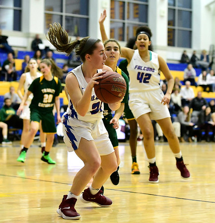 3/8/2019 Mike Orazzi | Staff St. Paul Catholic High School's Catherine Ciampi (21) during the Class S Semifinal girls basketball game with Trinity Catholic at Newtown High School Friday night in Newtown.