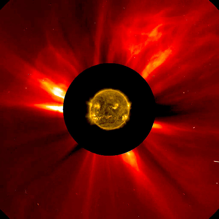 . A combined NASA handout image shows the sun\'s innermost atmosphere as seen by the Solar Dynamics Observatory (SDO) inside a larger image provided by the Solar and Heliospheric Observatory spacecraft (SOHO) taken November 8-9, 2012. A coronal mass ejection can be seen traveling away from the sun in the upper right corner.  REUTERS/ESA/NASA/Handout