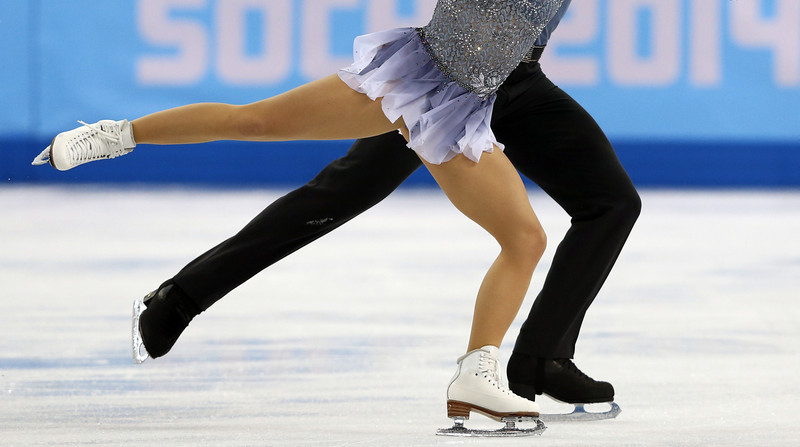 . Germany\'s Daniel Wende and Germany\'s Maylin Wende perform during the Figure Skating Pairs Team Short Program at the Iceberg Skating Palace during the Sochi Winter Olympics on February 6, 2014. (ADRIAN DENNIS/AFP/Getty Images)
