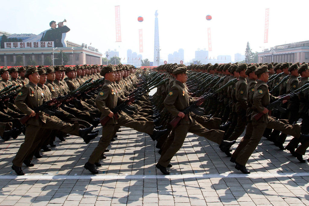 . North Korean troops march during a military parade at Kim Il Sung Square to mark the 65th anniversary of the country\'s founding in Pyongyang, North Korea, Monday, Sept. 9, 2013. (AP Photo/Jon Chol Jin)