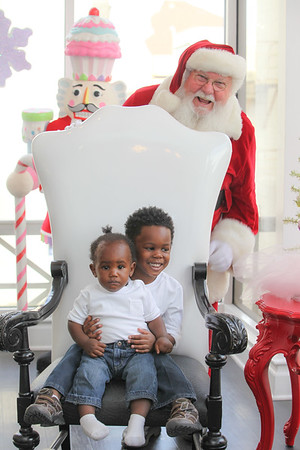 Cayson and Cai with Santa at Sweet Pete's Candy Shop
