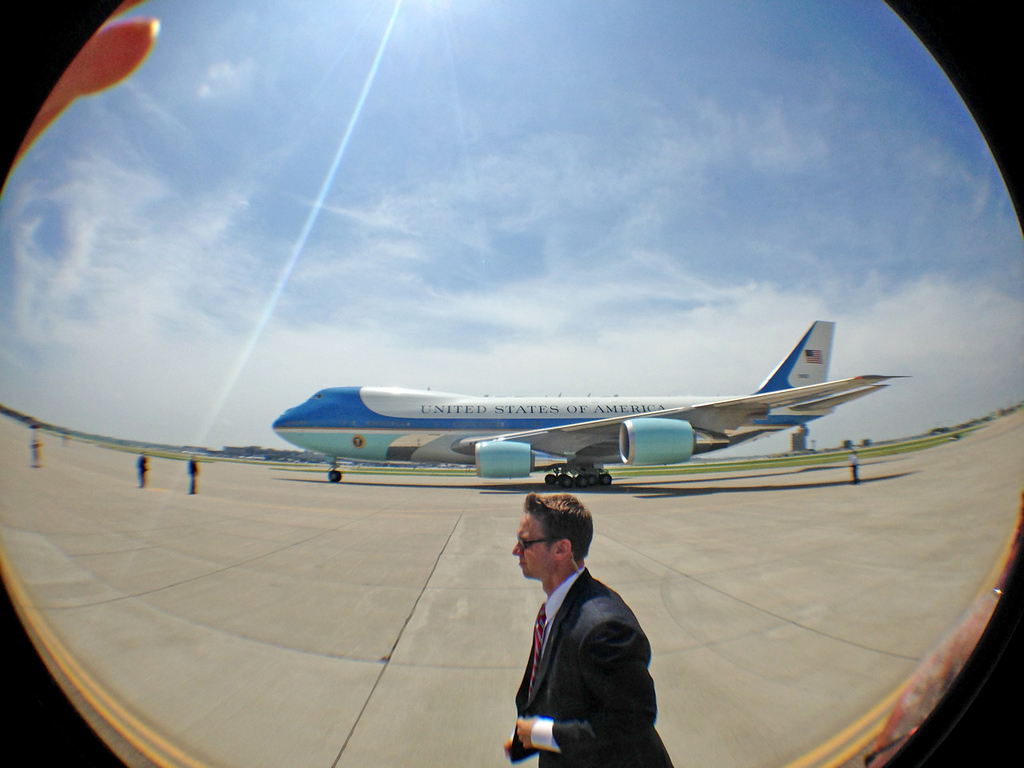 . A secret service agent walks alongside Air Force One as President Barack Obama lands at the Minneapolis-St. Paul International Airport for his two-day visit to the Twin Cities on Thursday.  (Pioneer Press: Ben Garvin)