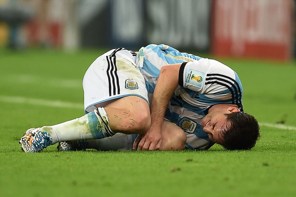. Lionel Messi of Argentina lies on the field after a foul during the 2014 FIFA World Cup Brazil Group F match between Argentina and Bosnia-Herzegovina at Maracana on June 15, 2014 in Rio de Janeiro, Brazil.  (Photo by Matthias Hangst/Getty Images)