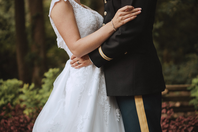 The bride and groom embracing.