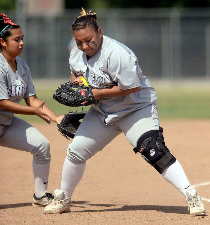 . Kennedy\'s Jessica Olvera fields the ball against Narbonne during the CIF City Section Div. I softball semifinal in Granada Hills, Ca May 21, 2013.(Andy Holzman/Staff Photographer)