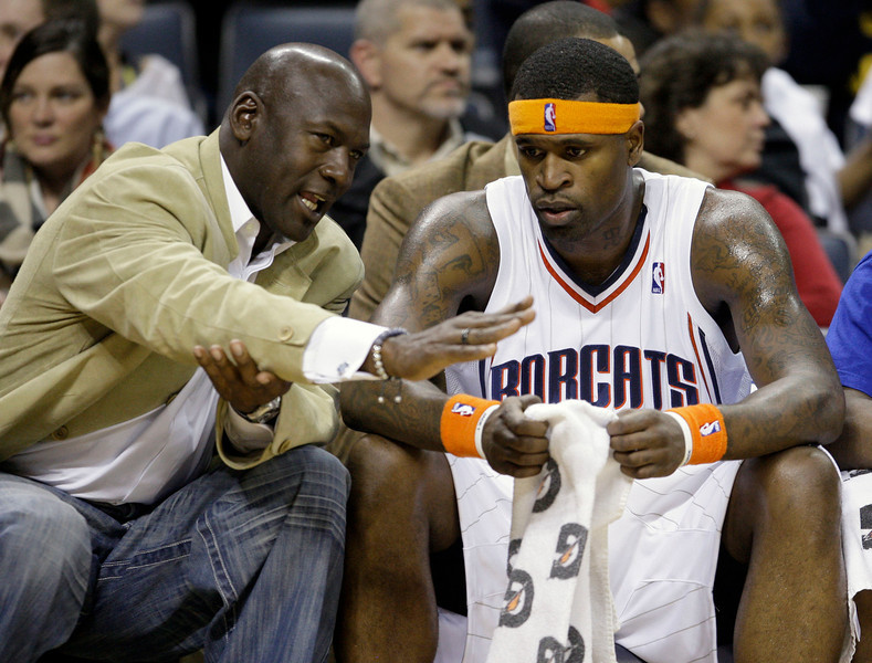 . In this Jan. 9, 2010, file photo, Charlotte Bobcats managing partner Michael Jordan, left, talks with player Stephen Jackson during the first half of an NBA basketball game against the Memphis Grizzlies in Charlotte, N.C. Jordan struck a deal late Friday, Feb. 26, 2010, to buy a controlling interest in the Bobcats, making the NBA\'s greatest player the owner of the money-losing team in his home state. (AP Photo/Chuck Burton, File)