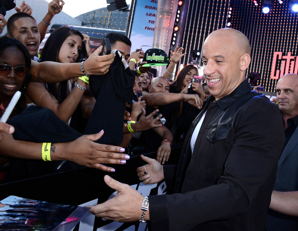 ". Actor Vin Diesel arrives at the LA Premiere of the ""Fast & Furious 6\"" at the Gibson Amphitheatre on Tuesday, May 21, 2013 in Universal City, Calif. (Photo by Dan Steinberg/Invision/AP)"
