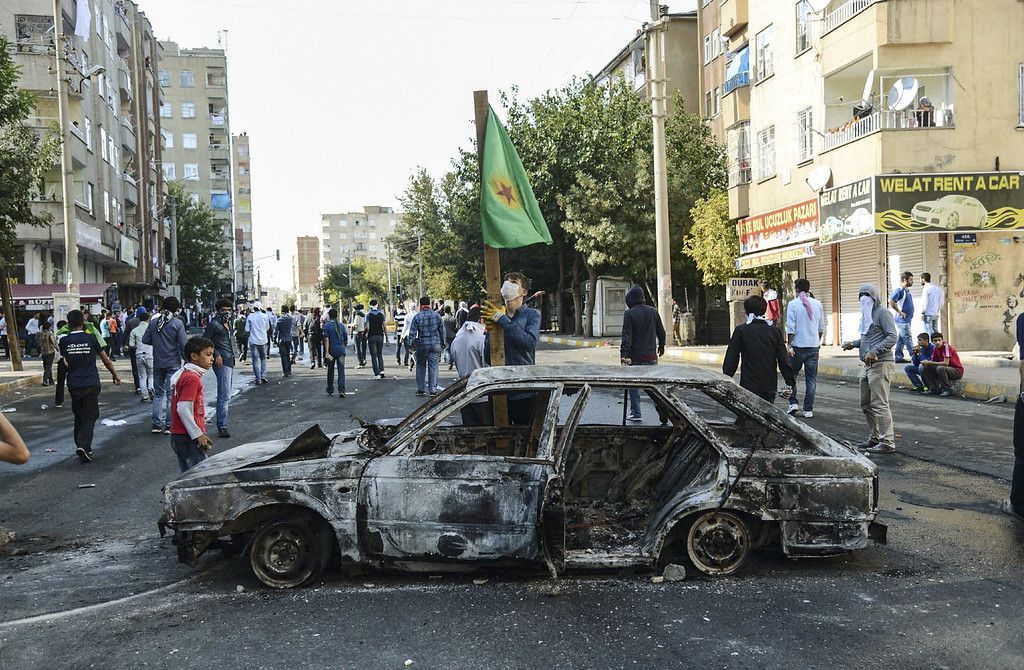. Kurdish protesters clash with Turkish riot policemen in the southeastern city of Diyarbakiron October 7, 2014 during a demonstration to demand more western intervention against Islamic State militants (IS) in Syria and Iraq. INILYAS AKENGIN/AFP/Getty Images