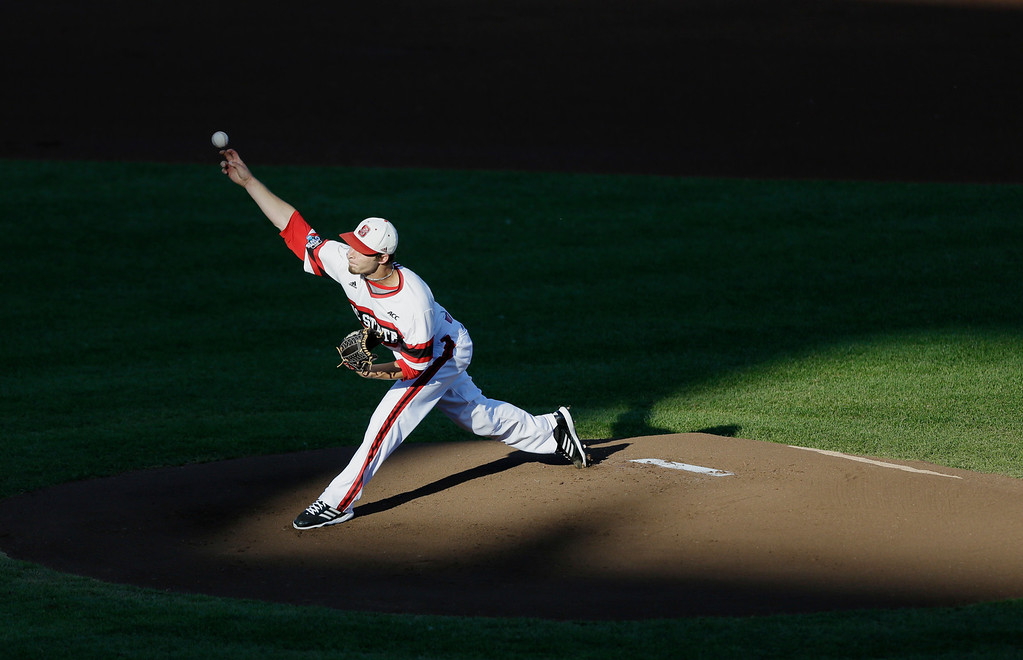 . North Carolina State starting pitcher Logan Jernigan delivers against UCLA in the first inning of an NCAA College World Series game in Omaha, Neb., Tuesday, June 18, 2013. (AP Photo/Nati Harnik)