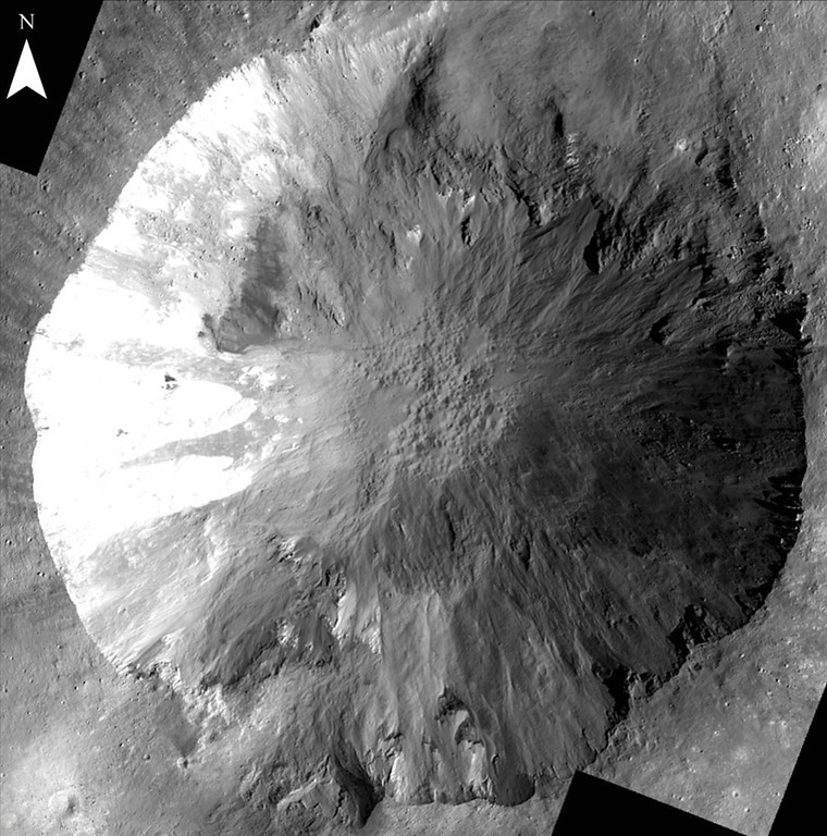 . This image provided by NASA shows long, narrow gullies along the walls of a crater on the giant asteroid Vesta taken by the NASA Dawn spacecraft. Scientists are unclear how these gullies formed and work is underway to determine their origin. (AP Photo/NASA)