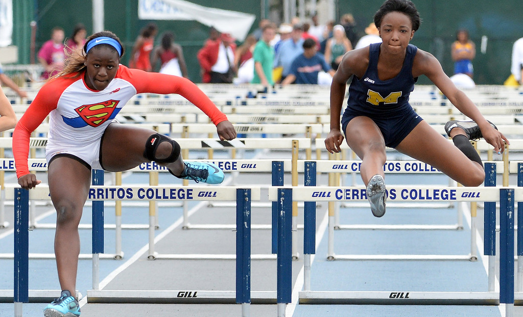 . Serra\'s Jeanette Paul, left, wins the division 4 100 meter high hurdles past Muir\'s Keeya Cotlage during the CIF Southern Section track and final Championships at Cerritos College in Norwalk, Calif., Saturday, May 24, 2014.   (Keith Birmingham/Pasadena Star-News)