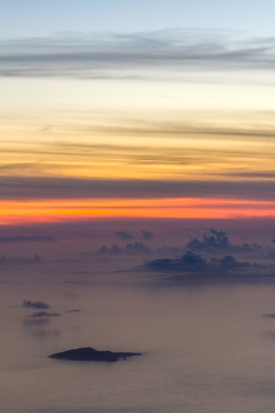 View of sea with clouds at sunset