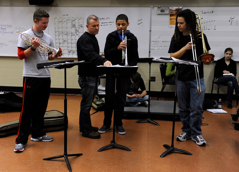 . The Denver School of the Arts Jazz Workshop Orchestra gets in some rehearsal time with their band director Dave Hammond, second from left,  in preparation for a trip to Savannah, GA for the the Savannah Music Festival\'s Swing Central Jazz competition. The DSA jazz orchestra is one of only 12 high schools across the nation to be chosen for the competition. (Photo By Kathryn Scott Osler/The Denver Post)
