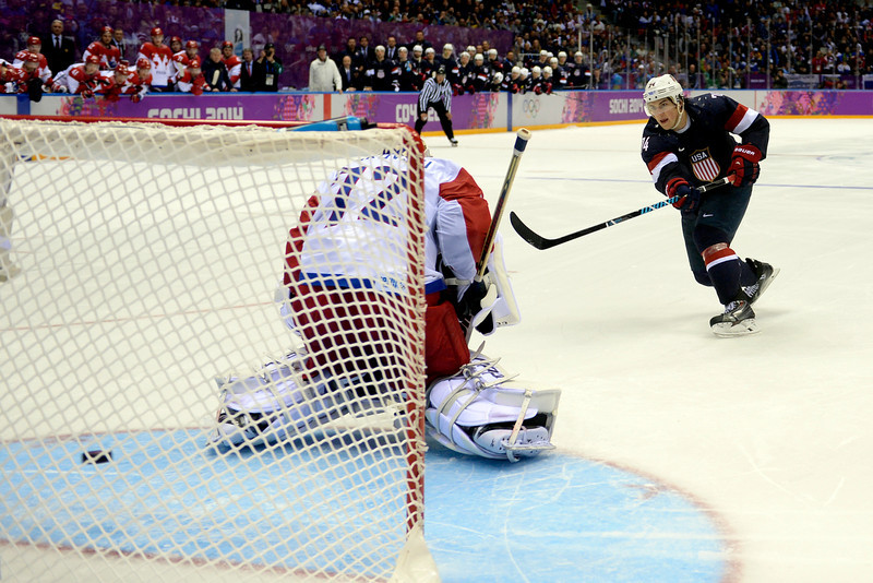 . T.J. Oshiet (74) of the U.S.A. makes the game-winning shot on Sergei Bobrovski (72) of the Russia during  the U.S.A.\'s shootout-win at Bolshoy arena. Sochi 2014 Winter Olympics on Saturday, February 15, 2014. (Photo by AAron Ontiveroz/The Denver Post)