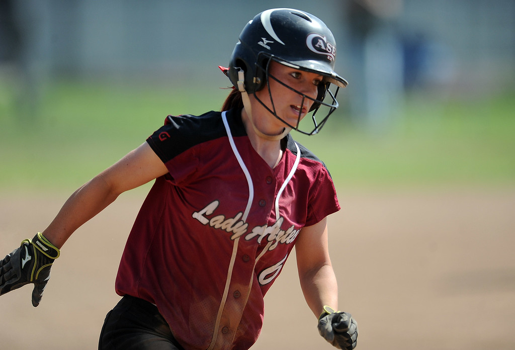 . Barstow\'s Jordan Neal scores on a base hit by Gabby Rodriguez (not pictured) in the third inning of a CIF-SS quarterfinal playoff softball game against Northview at Northview High School on Thursday, May 23, 2013 in Covina, Calif. Northview won 5-4.  (Keith Birmingham Pasadena Star-News)
