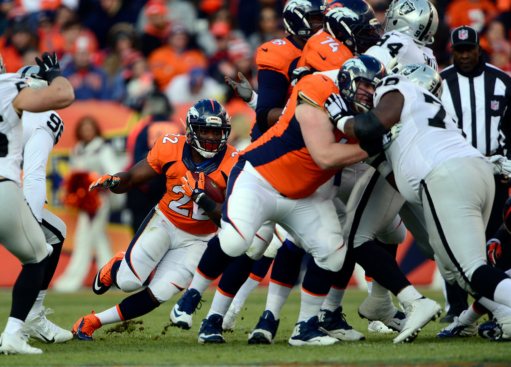 . DENVER, CO - DECEMBER 28: C.J. Anderson (22) of the Denver Broncos runs the ball through traffic in the first quarter.  The Denver Broncos played the Oakland Raiders at Sports Authority Field at Mile High in Denver on December, 28 2014. (Photo by Joe Amon/The Denver Post)