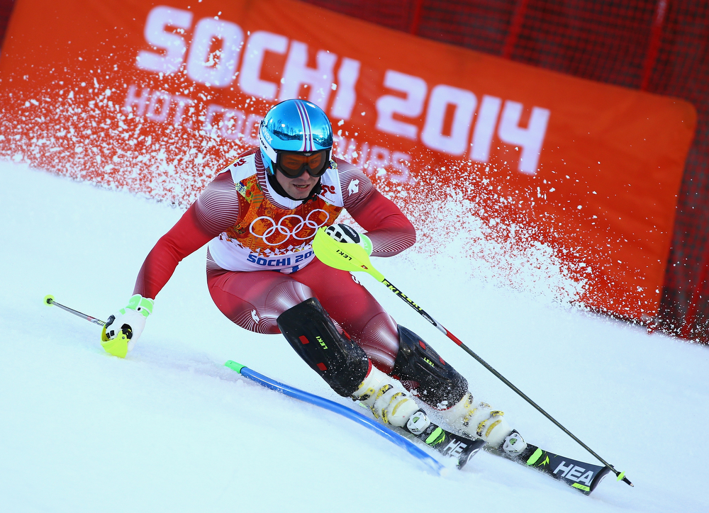 . Beat Feuz of Switzerland competes during the Alpine Skiing Men\'s Super Combined Downhill on day 7 of the Sochi 2014 Winter Olympics at Rosa Khutor Alpine Center on February 14, 2014 in Sochi, Russia.  (Photo by Doug Pensinger/Getty Images)