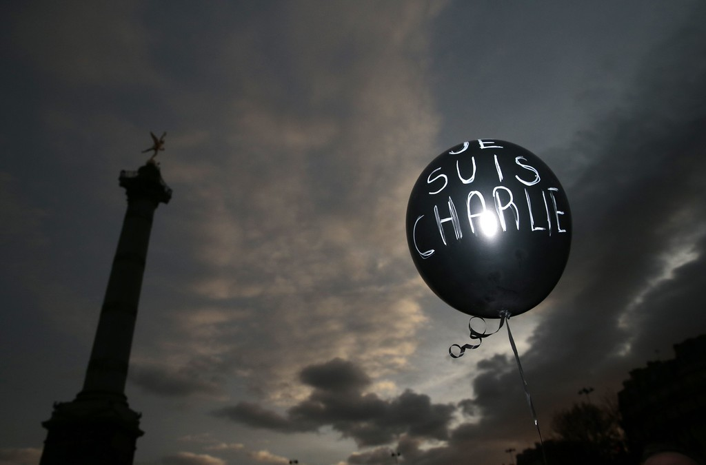 ". A balloon reading ""Je suis Charlie\"" (I am Charlie) is held at Place de la Bastille during the Unity rally \""Marche Republicaine\"" on January 11, 2015 in Paris in tribute to the 17 victims of a three-day killing spree by homegrown Islamists. The killings began on January 7 with an assault on the Charlie Hebdo satirical magazine in Paris that saw two brothers massacre 12 people including some of the country\'s best-known cartoonists, the killing of a policewoman and the storming of a Jewish supermarket on the eastern fringes of the capital which killed 4 local residents.    AFP PHOTO/ JOEL SAGETJOEL SAGET/AFP/Getty Images"