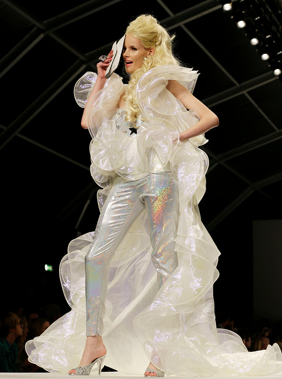 . A model wears a creation for Moschino women\'s Spring Summer 2015 collection, part of the Milan Fashion Week, unveiled in Milan, Italy, Thursday, Sept. 18, 2014. (AP Photo/Antonio Calanni)