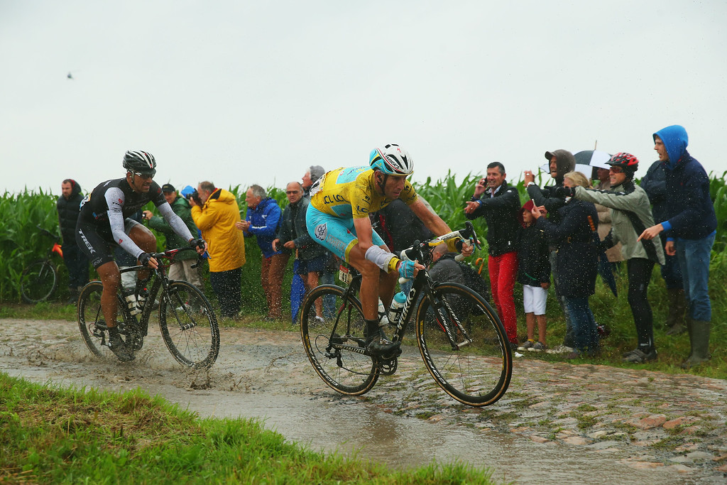 . Fabian Cancellara of Switzerland and Trek Factory Racing Team (L) and race leader Vincenzo Nibali of Italy and the Astana Pro Team in action on the pave during the fifth stage of the 2014 Tour de France, a 155km stage between Ypres and Arenberg Porte du Hainaut, on July 9, 2014 in Porte du Hainaut, France.  (Photo by Bryn Lennon/Getty Images)