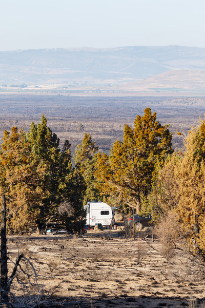 A small camper trailer is seen at the Indian Wells campground inLava beds national Monument - Lava Beds Campground Road, Tulelake, California, United States (US)