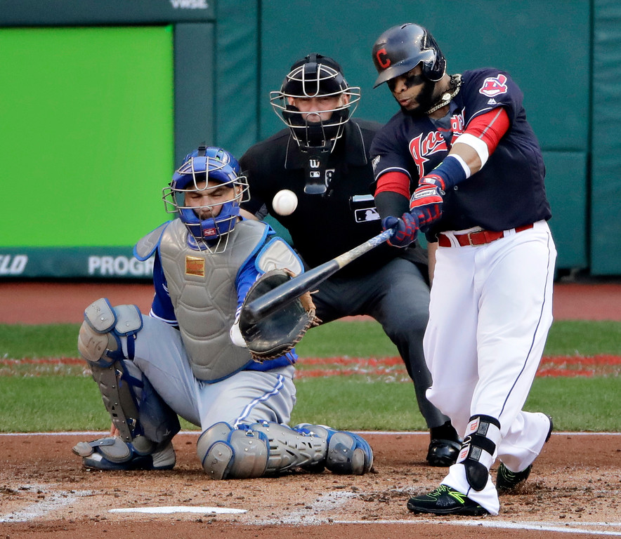 . Cleveland Indians\' Carlos Santana hits a home run against the Toronto Blue Jays during the second inning in Game 2 of baseball\'s American League Championship Series in Cleveland, Saturday, Oct. 15, 2016. (AP Photo/Charlie Riedel)