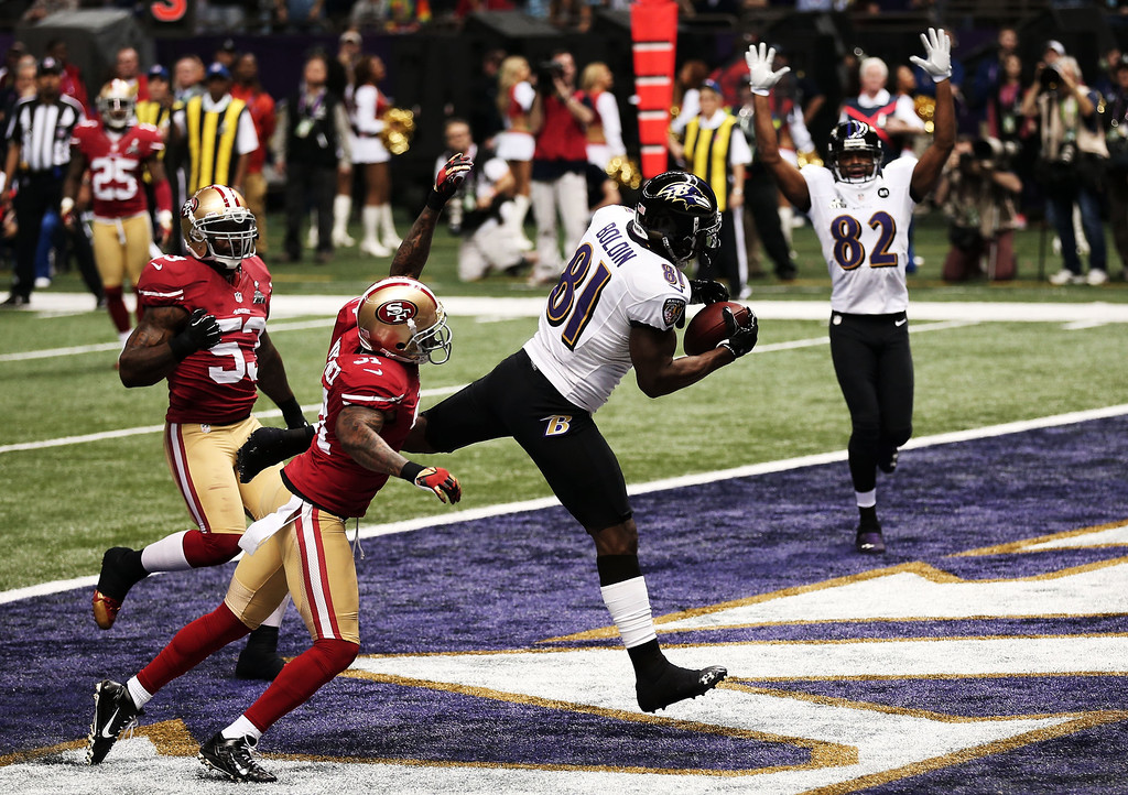 . Anquan Boldin #81 of the Baltimore Ravens makes a 13-yard touchdown reception in the first quarter from Joe Flacco #5 against Donte Whitner #31 of the San Francisco 49ers during Super Bowl XLVII at the Mercedes-Benz Superdome on February 3, 2013 in New Orleans, Louisiana.  (Photo by Win McNamee/Getty Images)