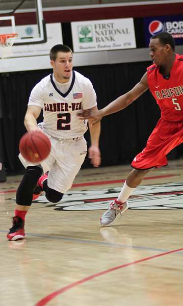 Tyler Strange(2) moves past Radford to pass the ball down the court.