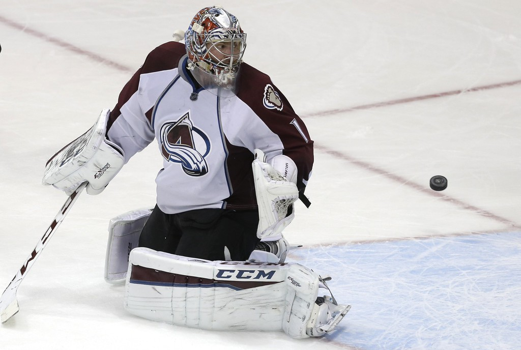 . Colorado Avalanche goalie Semyon Varlamov (1) can\'t stop the puck allowing a goal by Dallas Stars Erik Cole, not shown, during the second period of an NHL hockey game Tuesday, Feb. 3, 2015, in Dallas. (AP Photo/LM Otero)