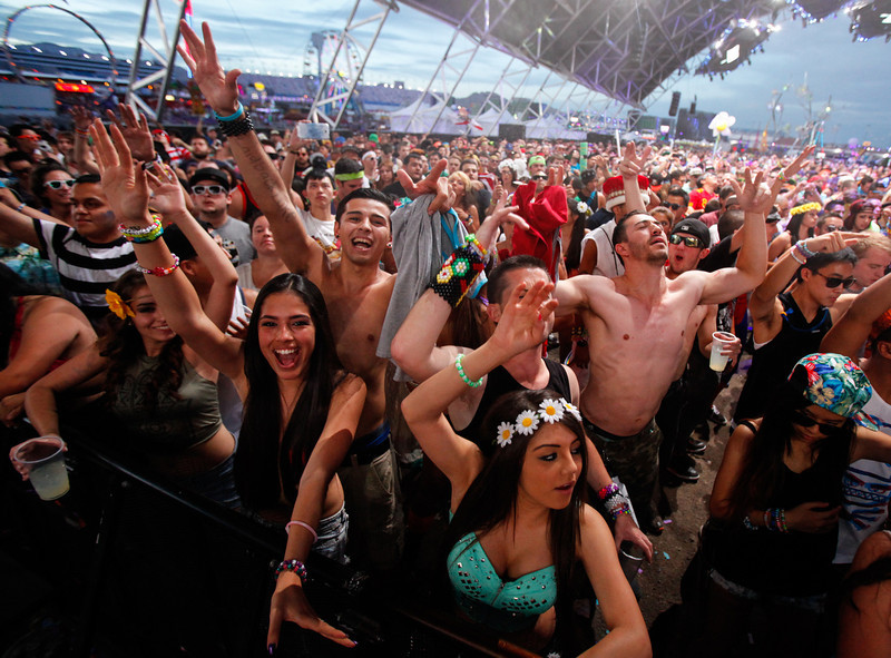 . In this Sunday, June 23, 2013 photo, festival-goers dance to Clockwork at the Circuit Grounds stage at the Electric Daisy Carnival at the Las Vegas Motor Speedway, in Las Vegas. (AP Photo/Las Vegas Review-Journal, Chase Stevens)