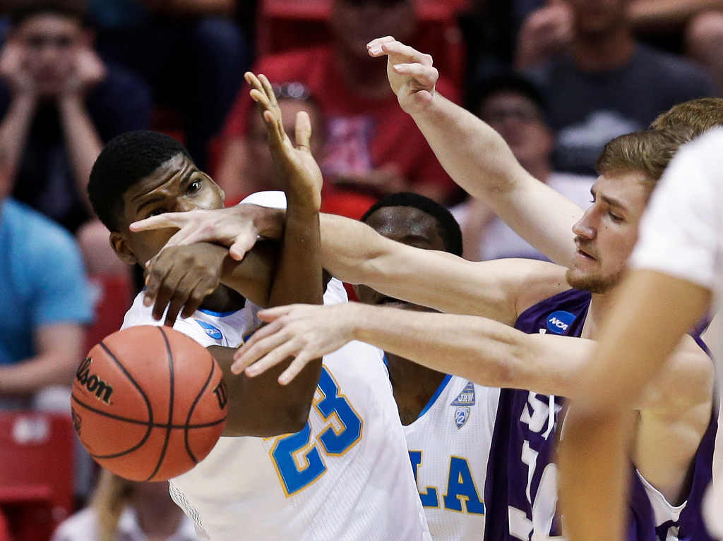 . UCLA center Tony Parker, left, battles Stephen F. Austin forward Tanner Clayton for the loose ball during the first half of a third-round game in the NCAA college basketball tournament, Sunday, March 23, 2014, in San Diego. (AP Photo/Gregory Bull)