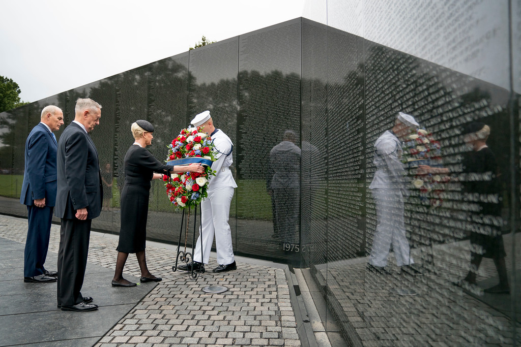 . Cindy McCain, wife of, Sen. John McCain, R-Ariz., accompanied by President Donald Trump\'s Chief of Staff John Kelly, left, and Defense Secretary Jim Mattis, second from left, lays a wreath at the Vietnam Veterans Memorial in Washington, Saturday, Sept. 1, 2018, during a funeral procession to carry the casket of her husband from the U.S. Capitol to National Cathedral for a Memorial Service. McCain served as a Navy pilot during the Vietnam War and was a prisoner of war for more than five years. (AP Photo/Andrew Harnik, Pool)