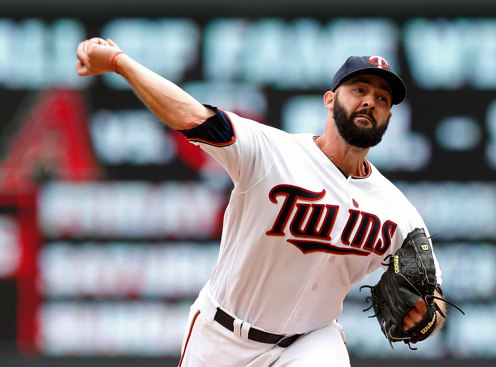 . Minnesota Twins pitcher Dillon Gee throws in relief in the fifth inning of the first game of a baseball doubleheader against the Cleveland Indians Thursday, Aug. 17, 2017, in Minneapolis. (AP Photo/Jim Mone)