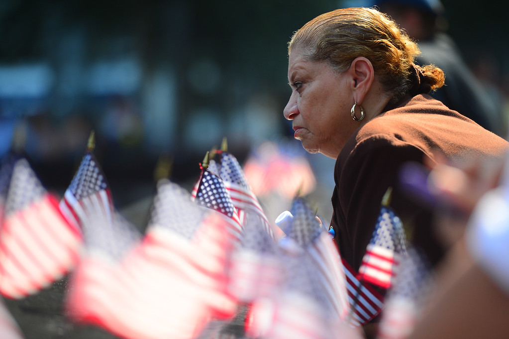 . Ruth Lamagne remembers her son, Port Authority police officer David Lamagne, at the 9/11 Memorial during ceremonies marking the 12th anniversary of the 9/11 attacks on the World Trade Center on September 11, 2013 in New York City.   (Photo by Alejandra Villa-Pool/Getty Images)