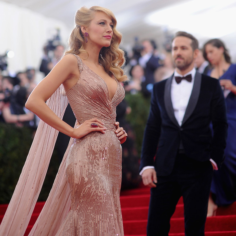 """. Blake Lively and Ryan Reynolds attend the \""""Charles James: Beyond Fashion\"""" Costume Institute Gala at the Metropolitan Museum of Art on May 5, 2014 in New York City.  (Photo by Dimitrios Kambouris/Getty Images)"""