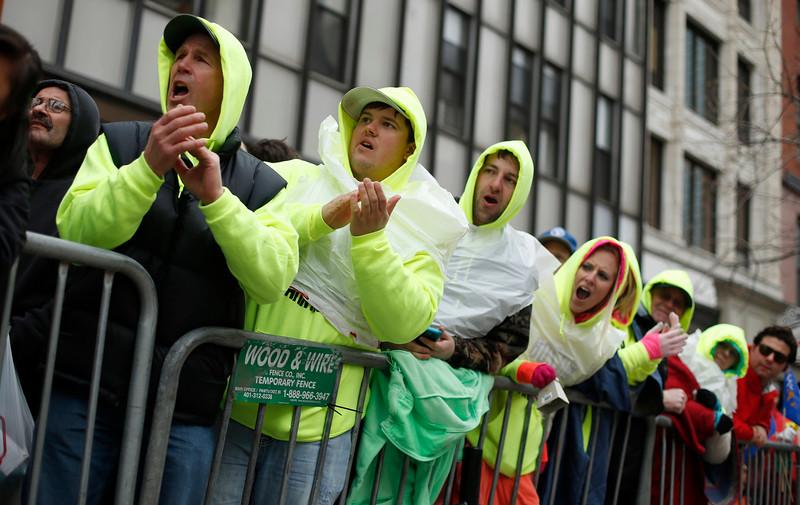 . Spectators cheer along the Boston Marathon race course, Monday, April 20, 2015, in Boston. (AP Photo/Robert F. Bukaty)
