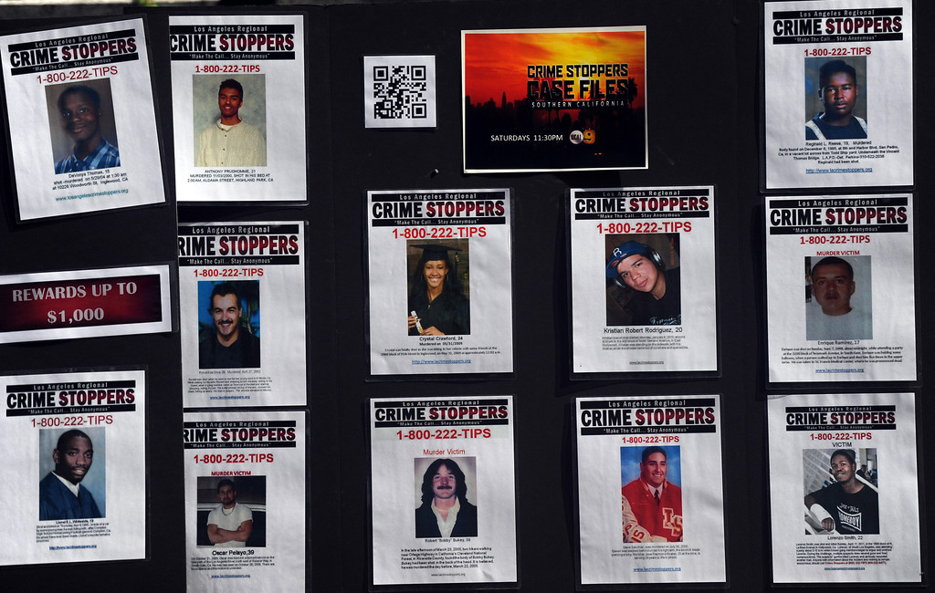 . Victims during a Los Angeles County Sheriff�s Department and Justice for Murdered Children unsolved homicide summit at the Los Angeles County Sheriff\'s headquarters on Saturday, July 20, 2013 in Monterey Park, Calif.  (Keith Birmingham/Pasadena Star-News)