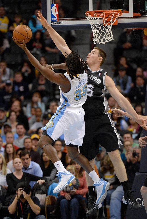 . Denver Nuggets small forward Kenneth Faried (35) goes up for a shot over San Antonio Spurs power forward Aron Baynes (16) during the first quarter October 14, 2013 at Pepsi Center. (Photo By John Leyba/The Denver Post)