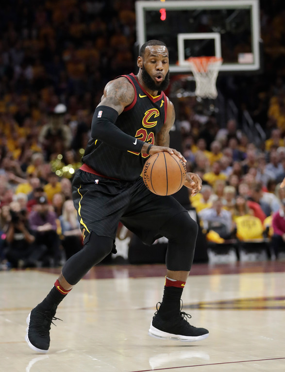. Cleveland Cavaliers\' LeBron James (23) handles the ball in the first half of Game 3 against the Boston Celtics in the NBA basketball Eastern Conference finals, Saturday, May 19, 2018, in Cleveland. (AP Photo/Tony Dejak)
