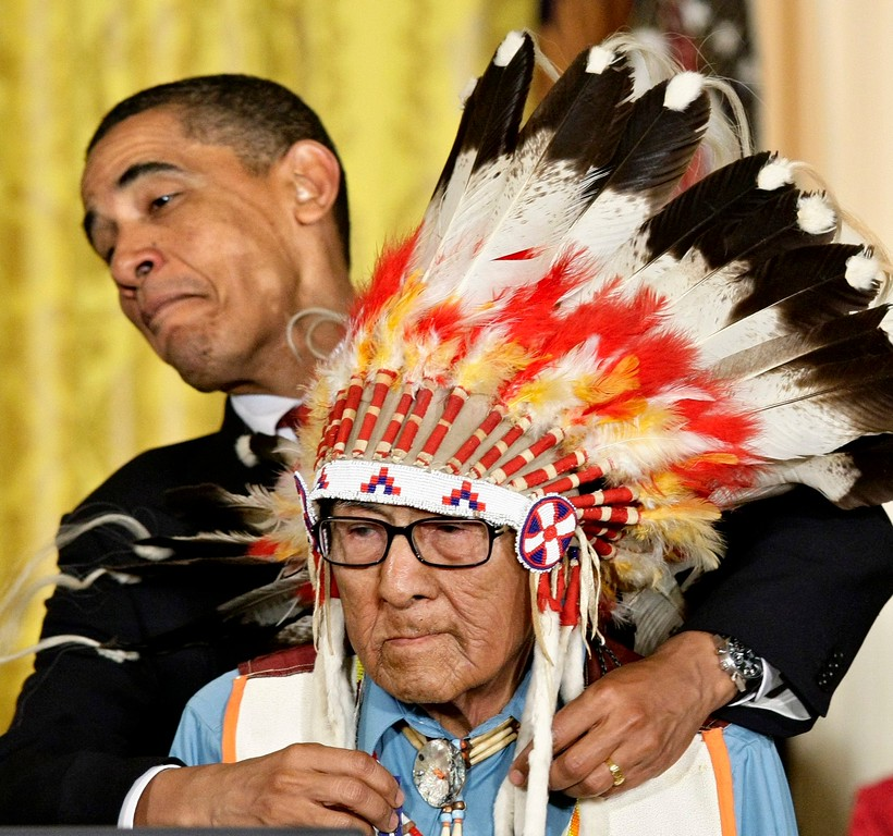 . President Barack Obama presents the 2009 Presidential Medal of Freedom to Joseph Medicine Crow during ceremonies at the White House in Washington, Wednesday, Aug. 12, 2009. (AP Photo/J. Scott Applewhite)