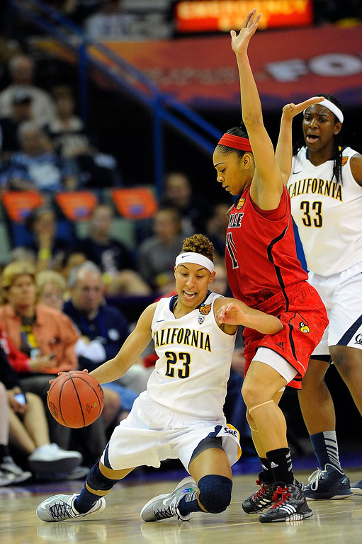 . Layisha Clarendon #23 of the California Golden Bears falls in front of Bria Smith #21 of the Louisville Cardinals during the National Semifinal game of the 2013 NCAA Division I Women\'s Basketball Championship at New Orleans Arena on April 7, 2013 in New Orleans, Louisiana. (Photo by Stacy Revere/Getty Images)
