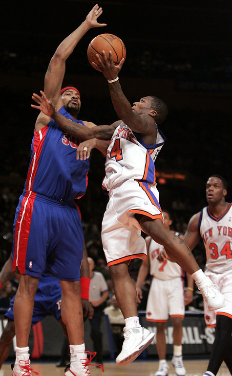 . New York Knicks\' Nate Robinson, right, goes up for a shot against Detroit Pistons\' Rasheed Wallace during the first quarter in NBA basketball action Thursday, Jan. 19, 2006, at Madison Square Garden in New York. Wallace blocked the shot on the play. (AP Photo/Julie Jacobson)