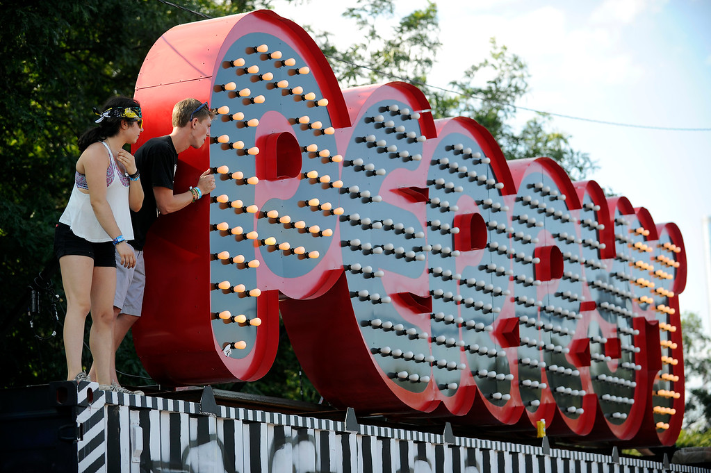 . Fans pose for a photo next to the Perry\'s sign during Lollapalooza at Grant Park on August 4, 2013 in Chicago, Illinois. (Photo by Seth McConnell/The Denver Post)