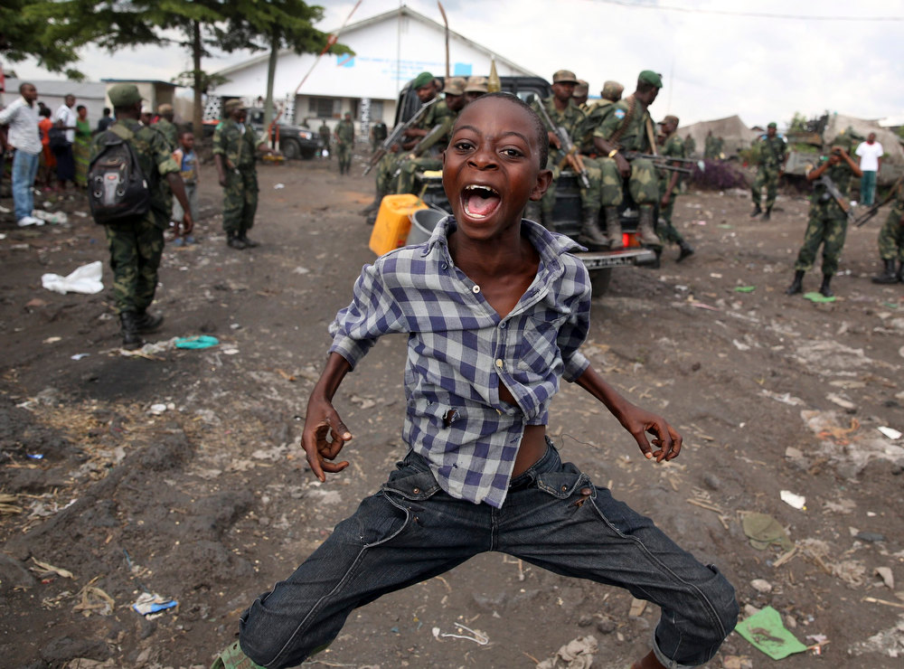 Description of . A boy dances to celebrate government army FARDC soldiers' return to Goma December 3, 2012. REUTERS/Goran Tomasevic