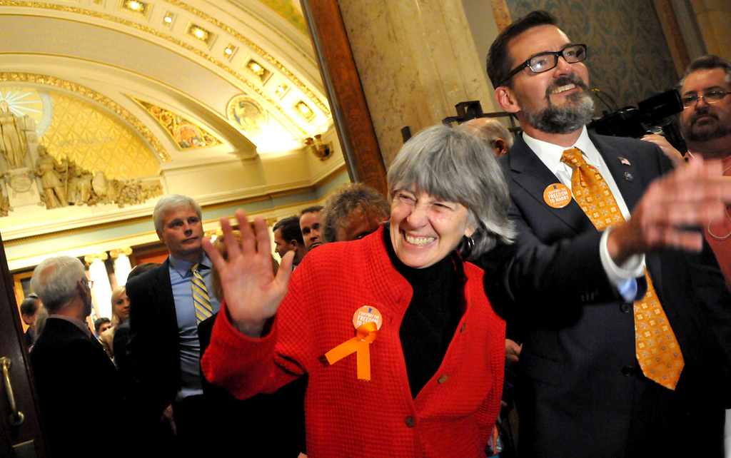 . Rep. Karen Clark and Sen. Scott Dibble, both sponsors of the same-sex marriage bills, leave the House chambers arm-in-arm after winning the House floor vote.  (Pioneer Press: John Doman)