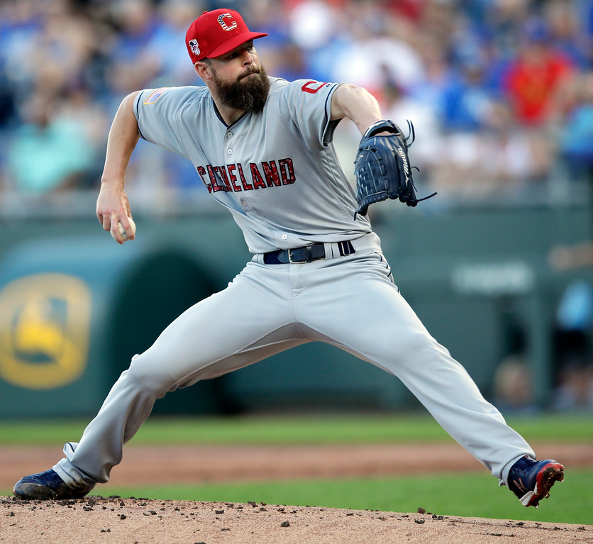 . Cleveland Indians starting pitcher Corey Kluber delivers to a Kansas City Royals batter during the first inning of a baseball game at Kauffman Stadium in Kansas City, Mo., Monday, July 2, 2018. (AP Photo/Orlin Wagner)