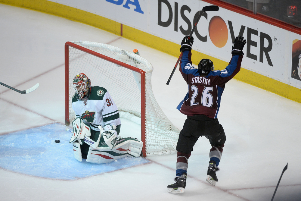 . Paul Stastny (26) of the Colorado Avalanche celebrates his game-winning goal as Ilya Bryzgalov (30) of the Minnesota Wild reacts during the overtime period of the Avs\' 5-4 win. The Colorado Avalanche hosted the Minnesota Wild during the first round of the NHL Stanley Cup Playoffs at the Pepsi Center on Thursday, April 17, 2014. (Photo by Karl Gehring/The Denver Post)