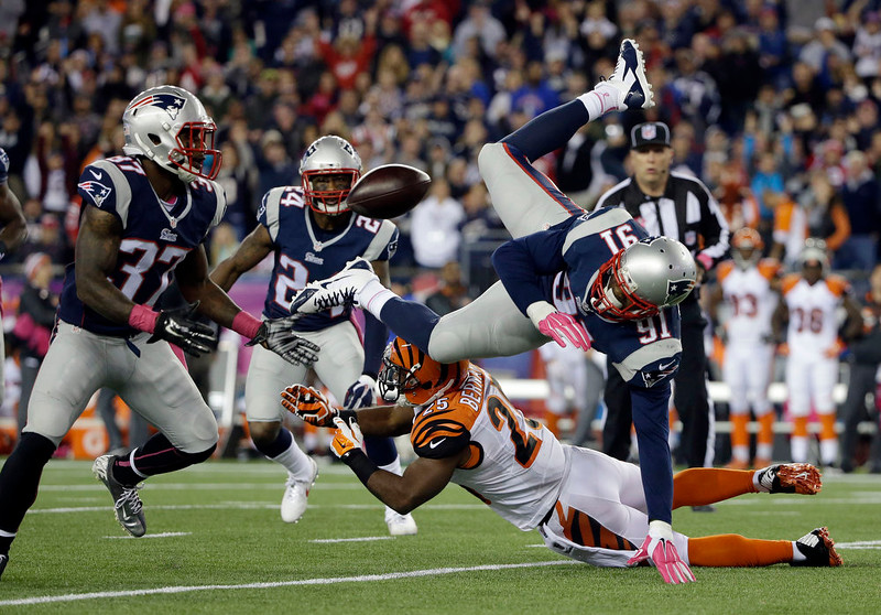 . Cincinnati Bengals running back Giovani Bernard (25) upends New England Patriots outside linebacker Jamie Collins (91), who fumbles in the first half of an NFL football game Sunday, Oct. 5, 2014, in Foxborough, Mass. Patriots cornerback Alfonzo Dennard (37) ended up with the ball. (AP Photo/Steven Senne)